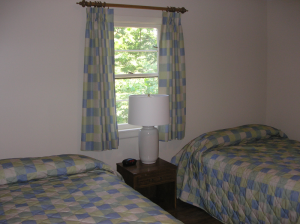 Bedroom in a Rough River Dam State Resort Park Cottage