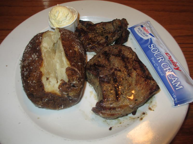 Baked Potato with Steak at Majestic Pizza and Steak House in Benton