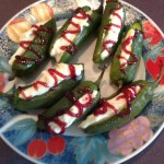 Two Sisters Cherry Bomb Hot Pepper Jam Drizzled on Cream Cheese Jalapeno Peppers
